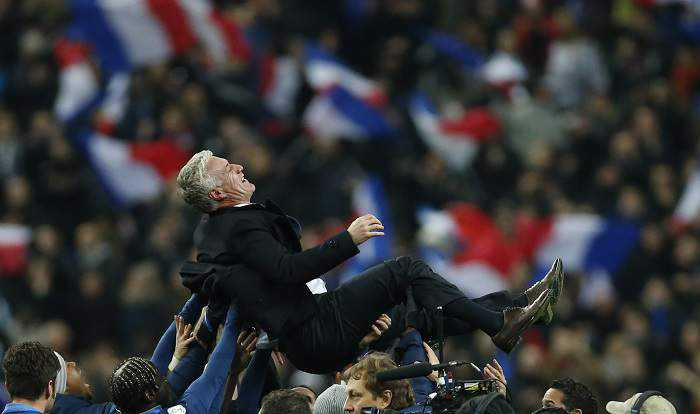 France's soccer team coach Deschamps is lifted in the air by his team after winning their 2014 World Cup qualifying second leg playoff soccer match against Ukraine at the Stade de France in Saint-Denis near Paris